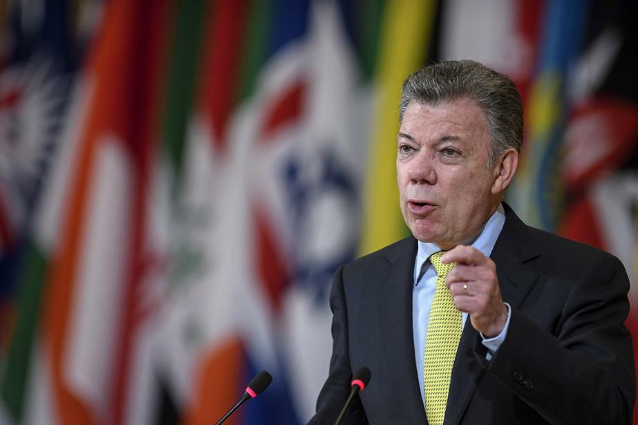 Juan Manuel Santos... (Martial Trezzini, Keystone via AP)