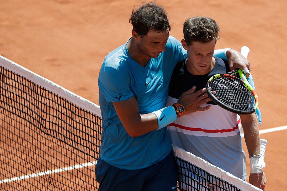 Rafael Nadal (à gauche) et Diego Schwartzman, photographiés... (Photo Thomas SAMSON, AFP)