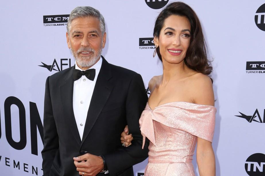 George et Amal Clooney ont fait un don... (Photo archives AP)