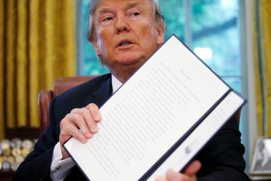 Donald Trump a signé le décret mercredi après-midi.... (Photo Leah Millis, REUTERS)