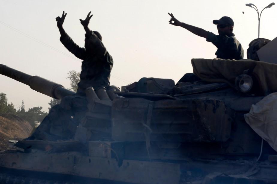 Des soldats de l'armée syrienne.... (Photo LOUAI BESHARA, archives Agence France-Presse)