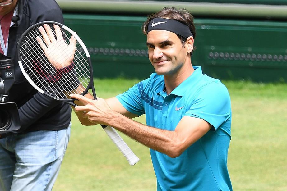 Roger Federer... (PHOTO CARMEN JASPERSEN, AGENCE FRANCE-PRESSE)