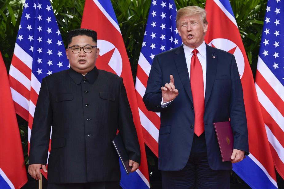 Kim Jong-un et Donald Trump lors de leur... (photo Susan Walsh, AP)