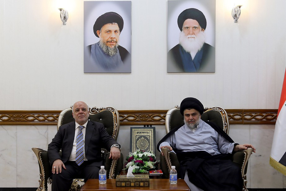 Le premier ministre irakien Haider al-Abadi et le... (PHOTO Haidar HAMDANI, AFP)