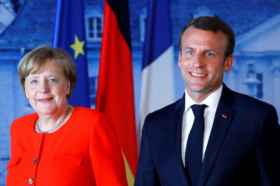 Angela Merkel et Emmanuel Macron.... (Photo Hannibal Hanschke, archives REUTERS)