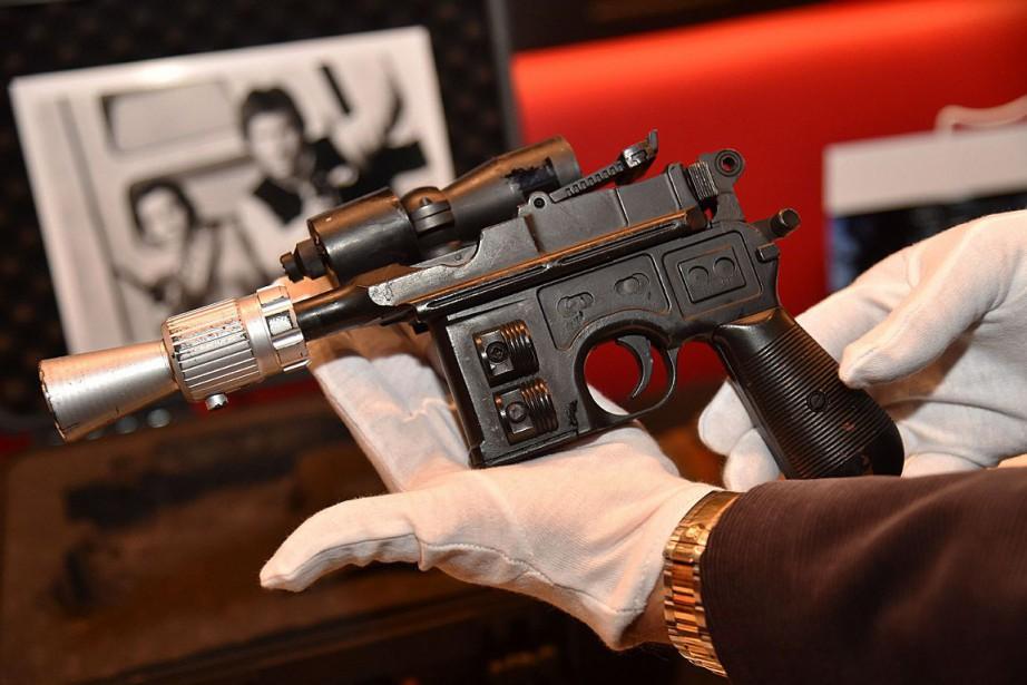 Le célèbre pistolet a été brandi par Harrison... (PHOTO HECTOR RETAMAL, AGENCE FRANCE-PRESSE)