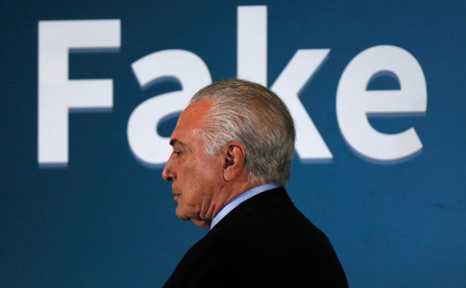 Le président brésilien Michel Temer quitte un séminaire... (Photo ADRIANO MACHADO, REUTERS)