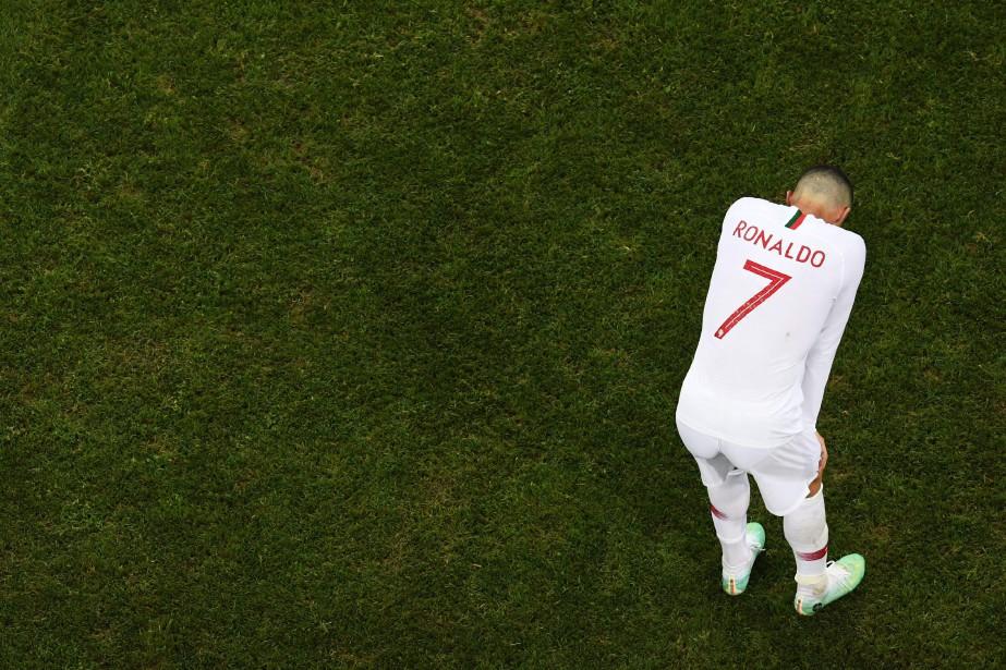 Le joueur portuguais Cristiano Ronaldo peine à cacher... (PHOTO  Kirill KUDRYAVTSEV, AFP)