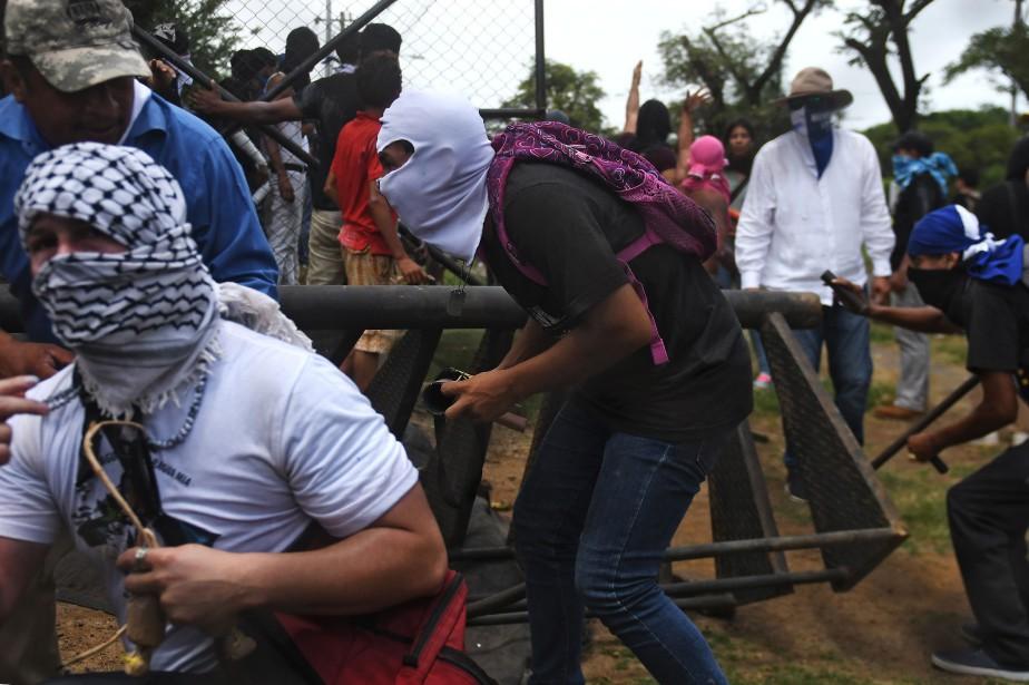 Le 30juin, au moins six personnes ont été... (PHOTO MARVIN RECINOS, Agence France-Presse)
