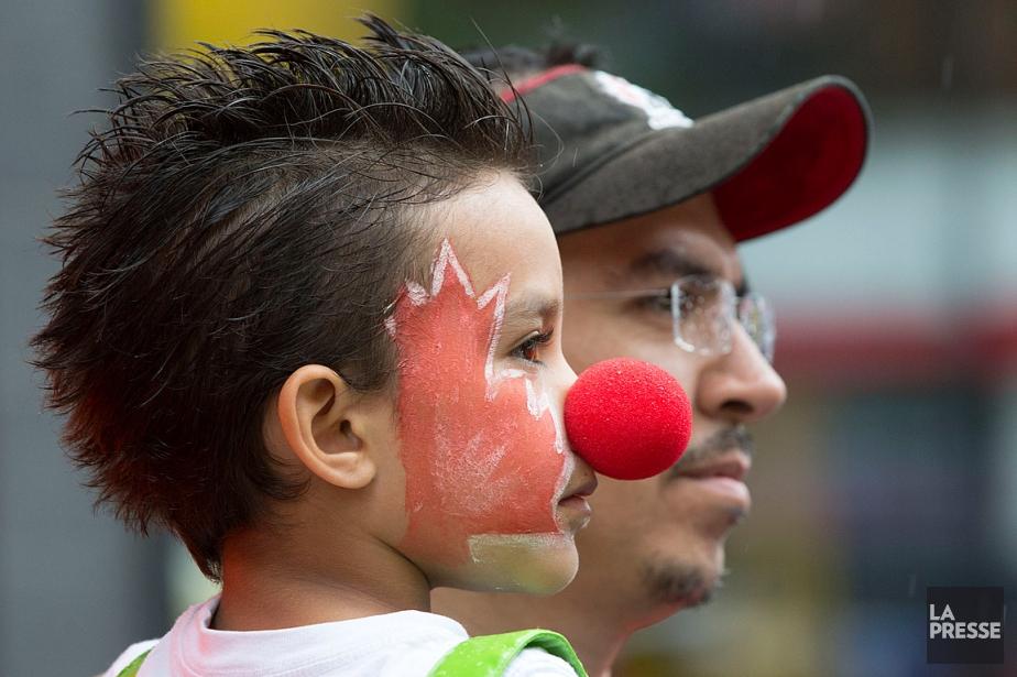 Ce jeune garçon assistait au défilé de la... (PHOTO ROBERT SKINNER, ARCHIVES LA PRESSE)