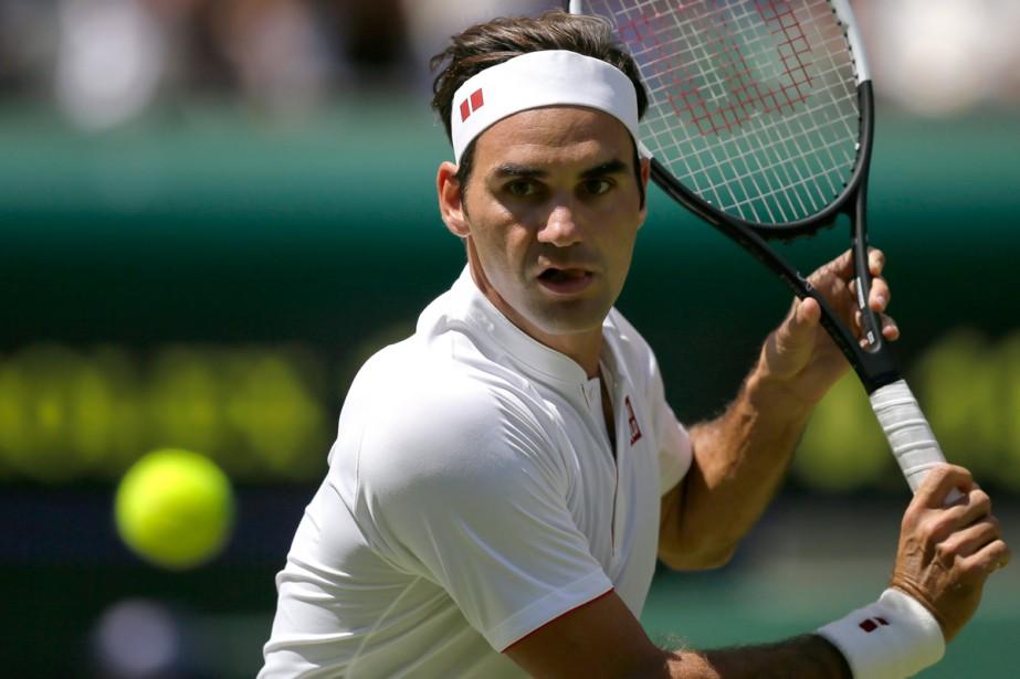 Roger Federer a réussi ses débuts sur le... (Photo AP)