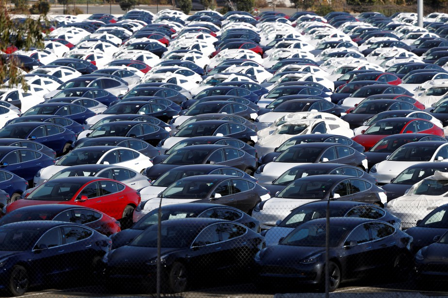 FILE PHOTO: A parking lot of predominantly new...