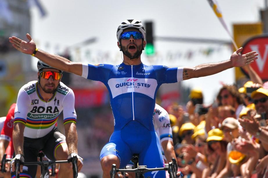 Le Colombien Fernando Gaviria célèbre sa première victoire... (Photo Marco Bertorello, AFP)