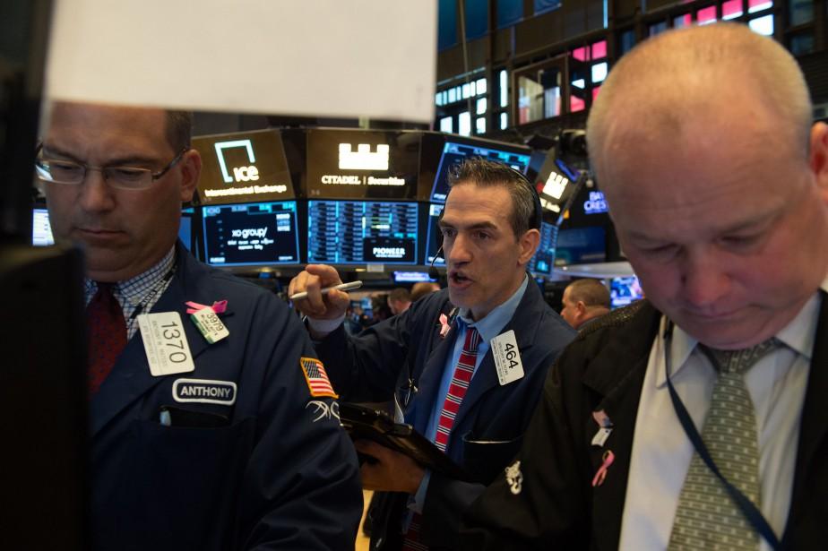 Le Dow Jones prenait 0,21% et le Nasdaq... (AFP)