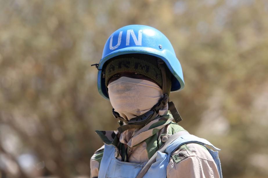 Un membre de la mission Onusienne au Darfour... (Photo Ashraf Shazly, Arhives AFP)