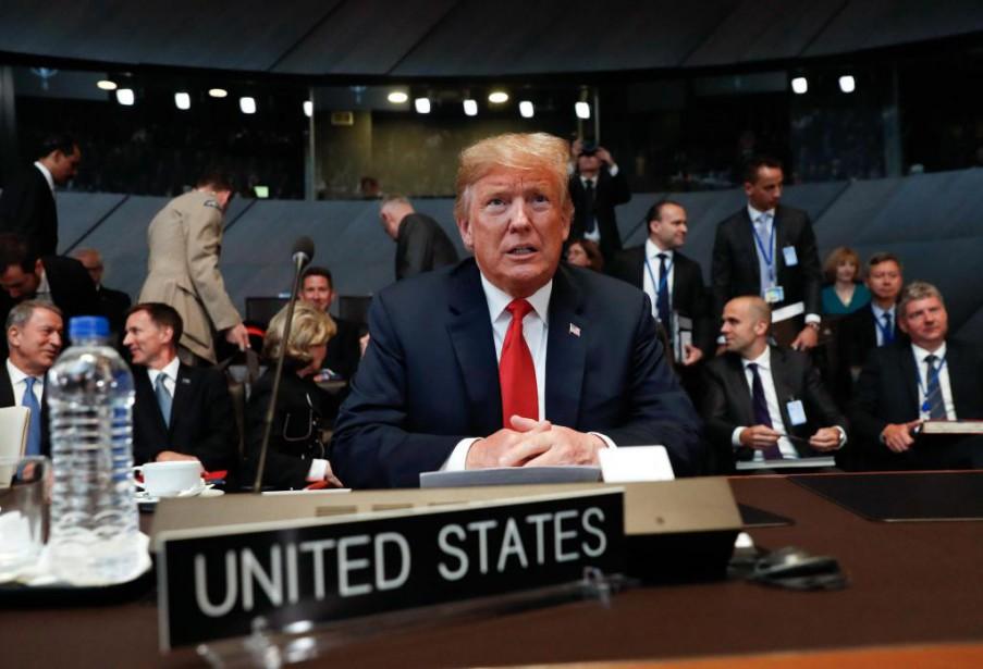 Le président américain Donald Trump (au centre) a... (PHotoBrendan Smialowski. Agence France-Presse)