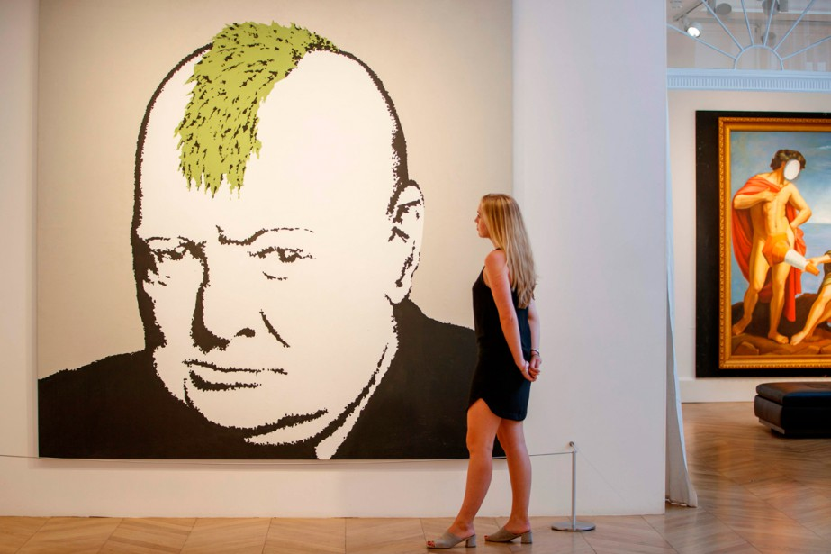 L'oeuvre Turf War (2003) de Banksy est exposée... (Photo AFP)