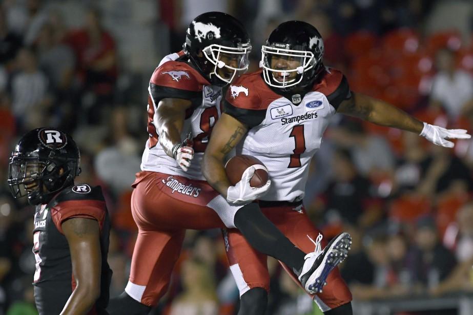 Lemar Durant (1) célèbre son touché avec Kamar... (Photo Justin Tang, La Presse Canadienne)