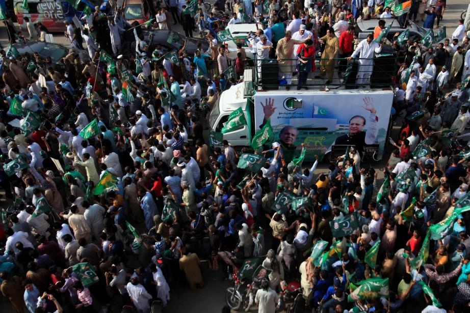 Des supporters de laLigue musulmane pakistanaise... (Photo Mohsin Raza, REUTERS)