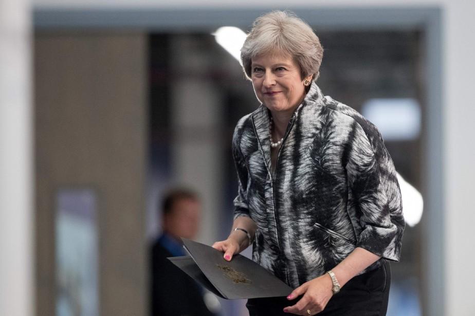 Theresa May... (PHOTO AFP)
