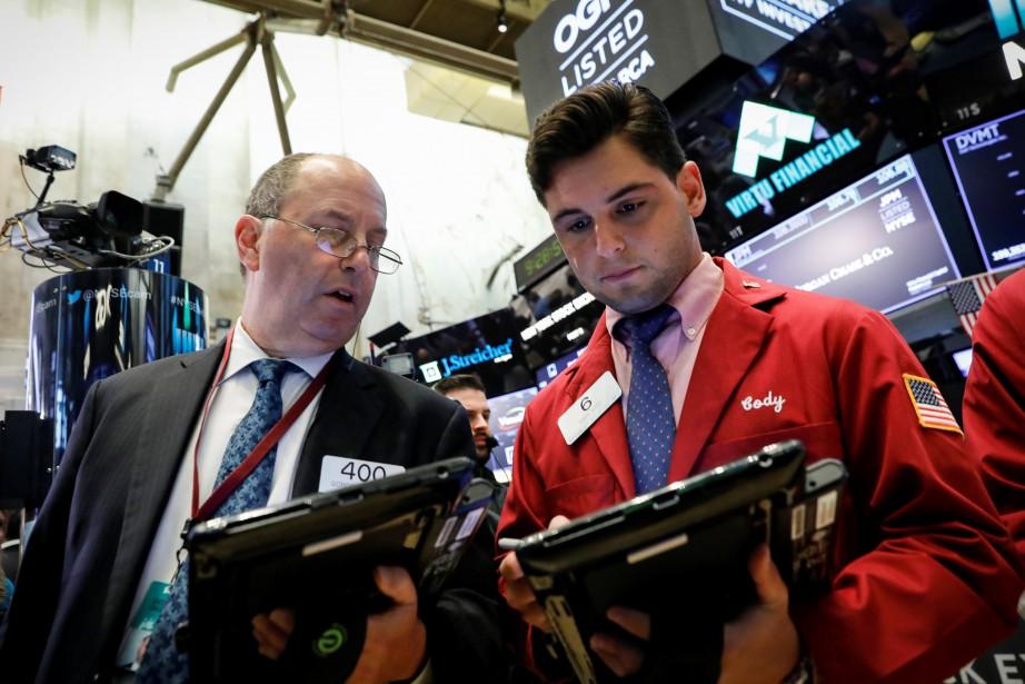 Le NASDAQ, à forte composante technologique, a cédé... (PHOTO ARCHIVES REUTERS)