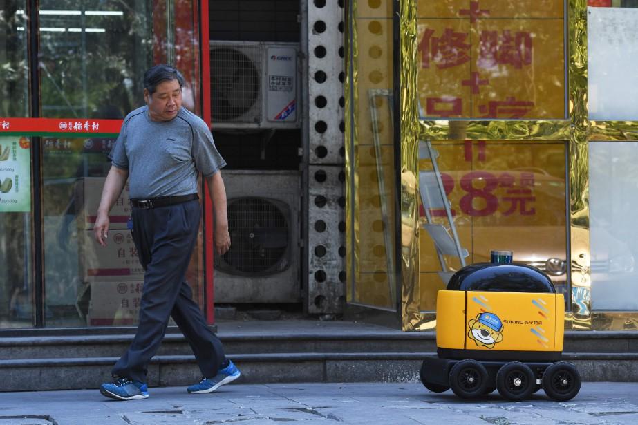 À Pékin, ces engins cubiques jaunes et noirs... (AFP)
