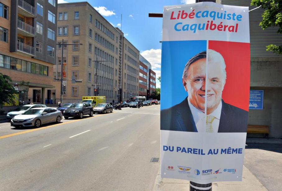 «Libécaquiste/Caquibéral», clament des milliers de pancartes qui seront... (Photo Patrice Laroche, Le Soleil)