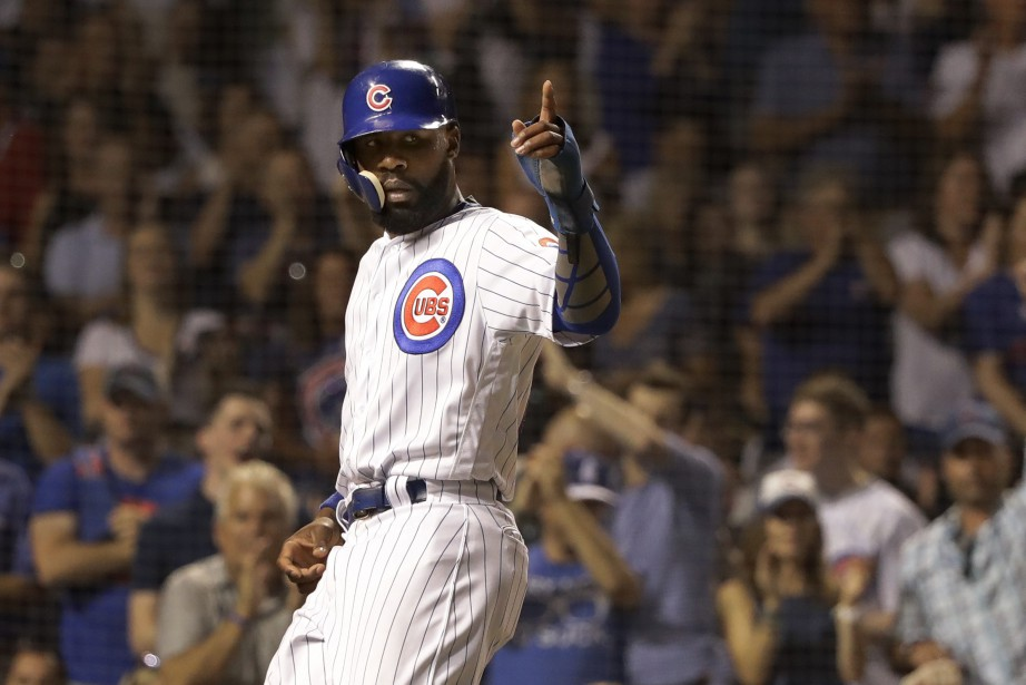Le joueur de champ des Cubs, Jason Heywards.... (Photo Charles Rex Arbogast, AP)