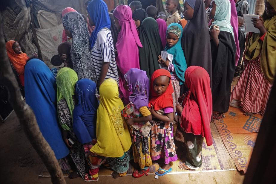 Environ 98 % des femmes et des filles... (PHOTO ARCHIVES AFP)