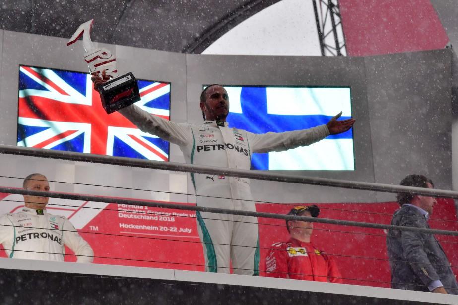 TOPSHOT - Mercedes' British driver Lewis Hamilton celebrates...