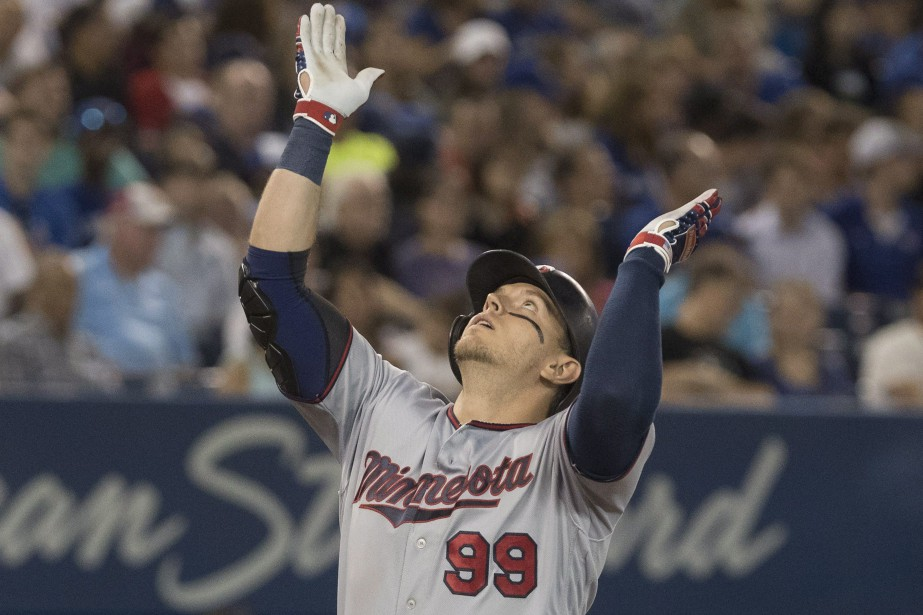 Logan Morrison célèbre son coup de circuit.... (PHOTO PC)