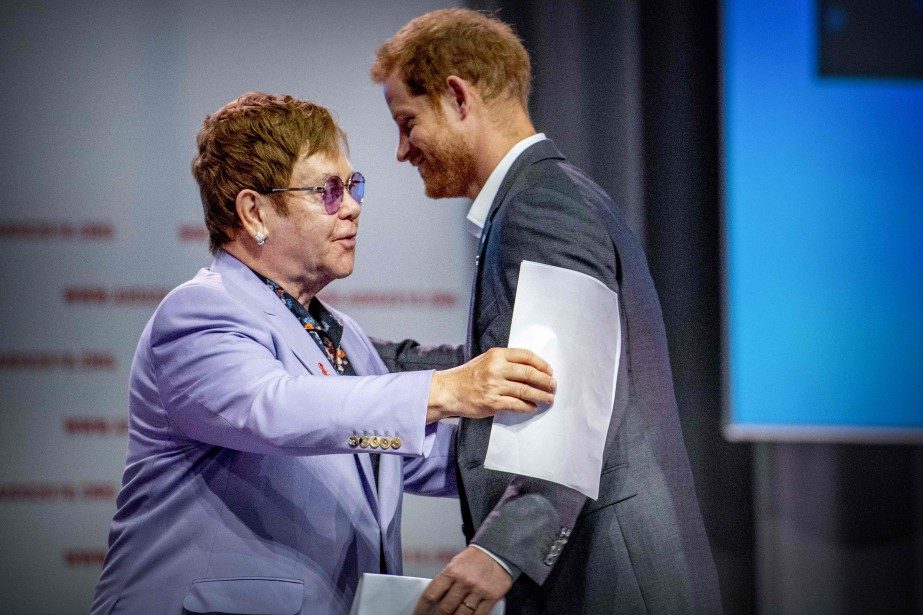 Elton John et le prince Harry... (Photo Robin Utrecht, Agence France-Presse)