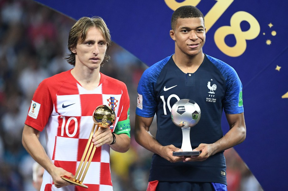 Luka Modric et Kylian Mbappé... (Photo Franck Fife, AFP)