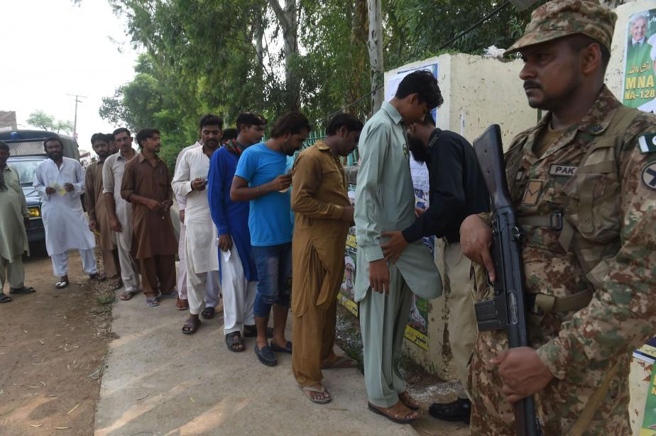 Les élections de mercredi, placées sous très haute... (Photo Arif Ali, Agence France-Presse)