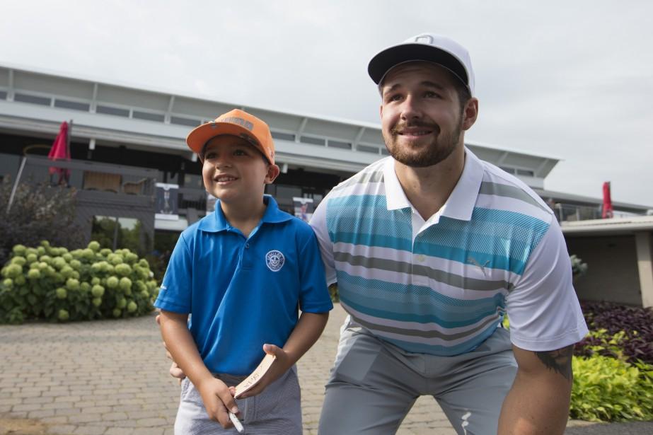 Le jeune Alexandre Luxemberg, 8 ans, et Xavier Ouellet | 28 août 2018