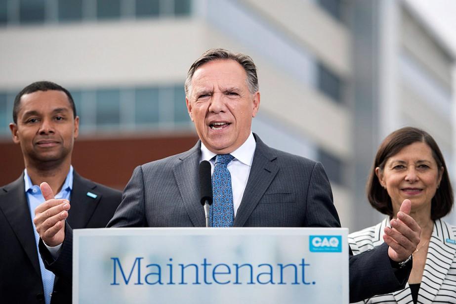 Le chef caquiste François Legault était accompagné par... (PHOTO GRAHAM HUGHES, LA PRESSE CANADIENNE)