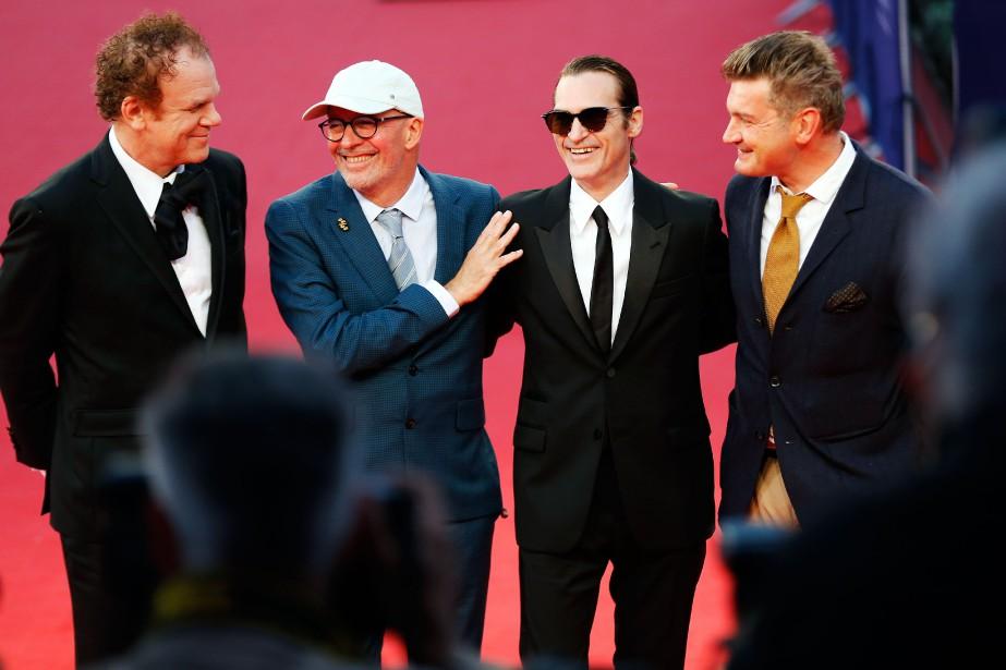 L'acteur John C. Reilly, le cinéaste français Jacques... (Photo CHARLY TRIBALLEAU, AFP)