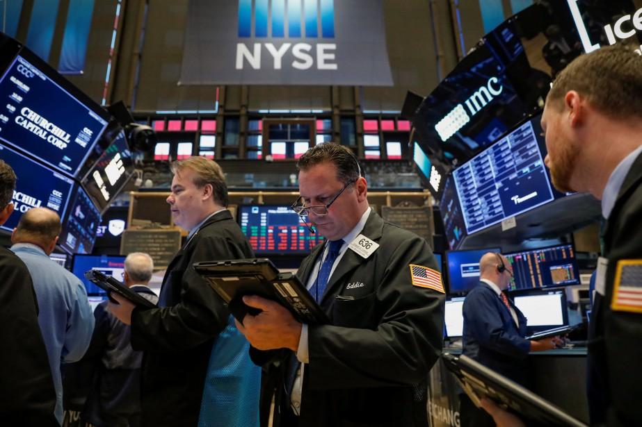 Le Dow Jones prenait 0,33% et le Nasdaq... (REUTERS)