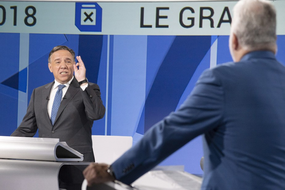 Le chef de la CAQ François Legault et... (PHOTO LA PRESSE CANADIENNE)