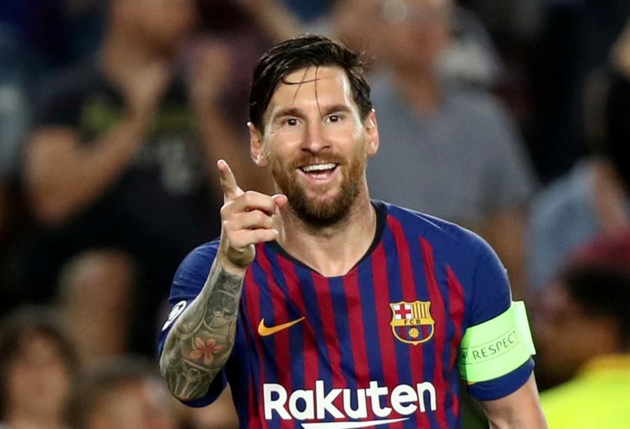 Lionel Messi célèbre son 3e but du match,... (REUTERS)