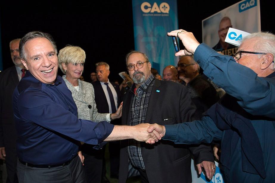 François Legault a été accueilli par ses partisans... (PHOTO GRAHAM HUGHES, LA PRESSE CANADIENNE)