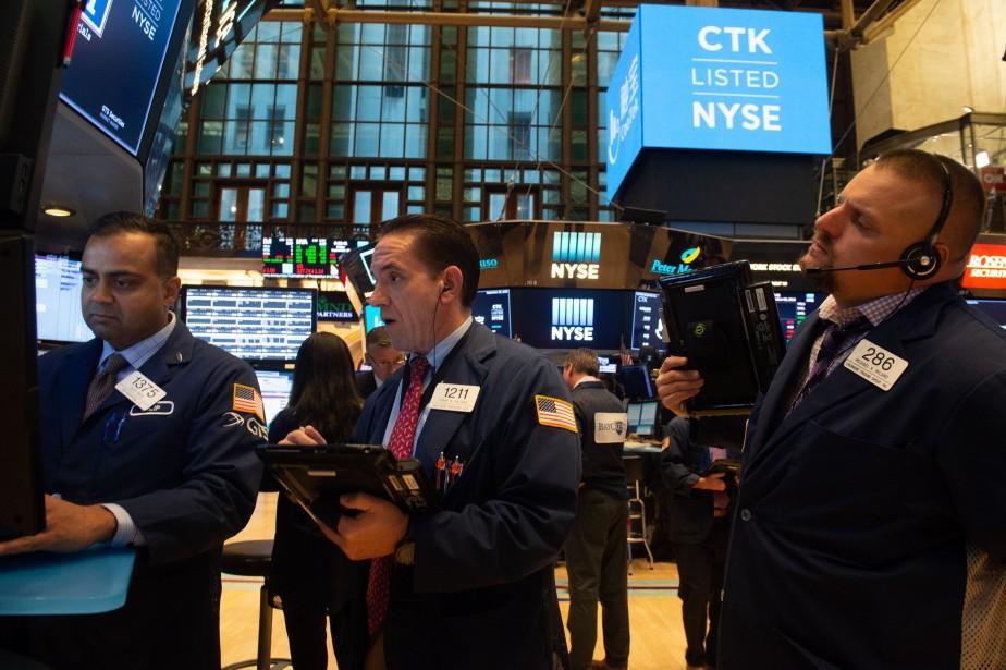 Le Dow Jones gagnait 0,60% et le Nasdaq... (AFP)