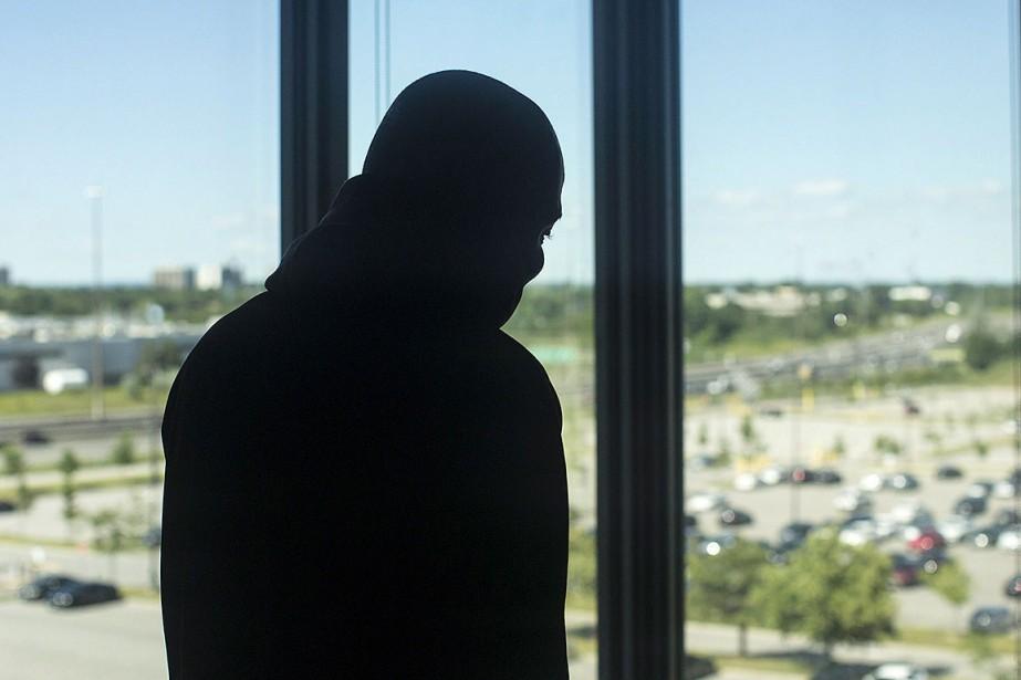 Sur cette photo, un migrant logé temporairement à... (Photo Chris Young, ARCHIVES PC)