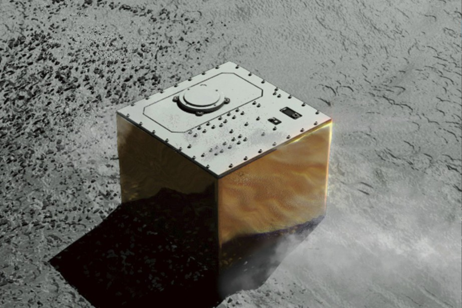 Tandis que le petit robot franco-allemand MASCOT se... (PHOTO AP)