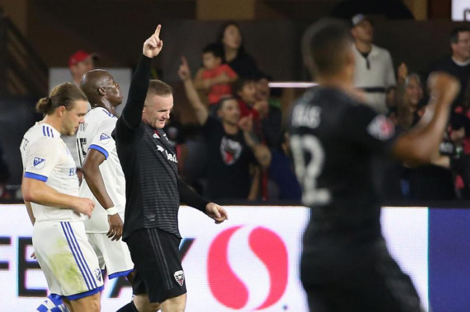 Wayne Rooney (9), du DC United, célèbre la... (PhotoGeoff Burke, USA TODAY Sports)
