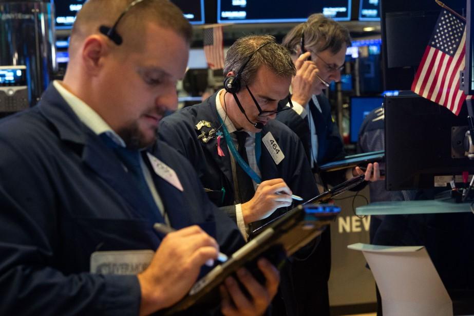 Wall Street a terminé en ordre dispersé mardi, les... (Photo BRYAN R. SMITH, AFP)