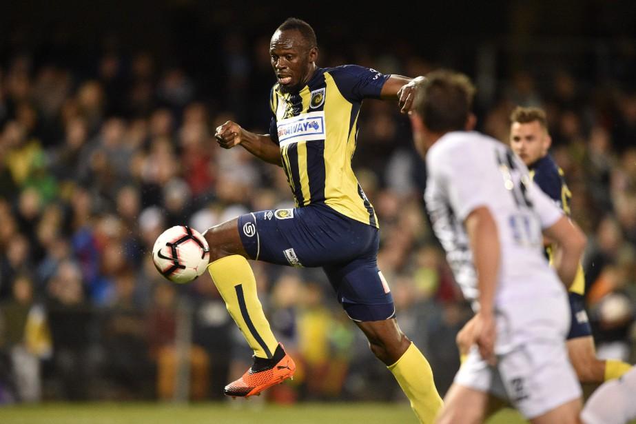 Usain Bolt... (PHOTO PETER PARKS, AFP)