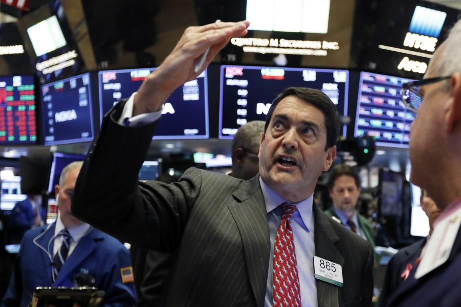 Wall Street et les marchés asiatiques... (Photo Richard Drew, Associated Press)
