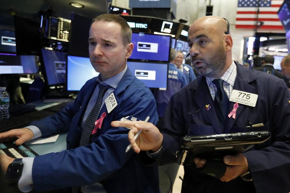 Le Dow Jones a gagné 2,17%, à 25798,42... (Photo Richard Drew, AP)