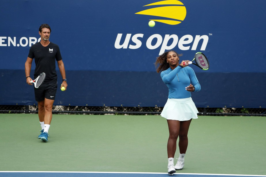 Serena Williams et son entraîneur Patrick Mouratoglou... (Photo Adam Hunger, Associated Press)